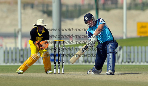 T20 World Cup Qualifying match - Scotland V Uganda at the ICC Global Cricket Academy - Dubai - pic shows Gordon Goudie hiting the first of consecutive sixes which both cleared not only the boundary rope but passed the over the sight screen and landed outside the complex perimeter - Uganda keeper is Lawrence Sematimba - Scotland won by 34 runs - Picture by Donald MacLeod  15.3.12  07702 319 738  clanmacleod@btinternet.com