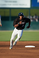 Bryce Bush (30) of the Kannapolis Intimidators hustles towards third base against the Augusta GreenJackets at Kannapolis Intimidators Stadium on June 21, 2019 in Kannapolis, North Carolina. The Intimidators defeated the GreenJackets 6-1. (Brian Westerholt/Four Seam Images)