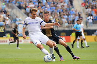 Jimmy Conrad (12) of the Kansas City Wizards and Sebastien Le Toux (9) of the Philadelphia Union. The Philadelphia Union and the Kansas City Wizards played to a 1-1 tie during a Major League Soccer (MLS) match at PPL Park in Chester, PA, on September 04, 2010.