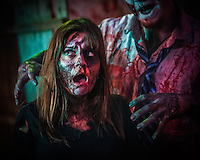 A victim and her attacker at the Texas Chainsaw Massacre attraction at Reapers Realm