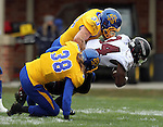 BROOKINGS, SD - OCTOBER 5:  T.J. Lalley #33 and Jake Gentile #38 from South Dakota State Universitybrings down Ken Malcome #34 from Southern Illinois in the first quarter Saturday afternoon at Coughlin Alumni Stadium in Brookings. (Photo by Dave Eggen/Inertia)