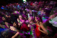 Students party in the Dena'ina Center during UAA's 2014 Homecoming Dance. Photo by James R. Evans