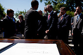 United States President Barack Obama greets guests after signing a Presidential Memorandum outlining the next steps in his vision for cleaner and more efficient vehicles, in the Rose Garden of the White House, Friday, May 21, 2010. .Mandatory Credit: Pete Souza - White House via CNP