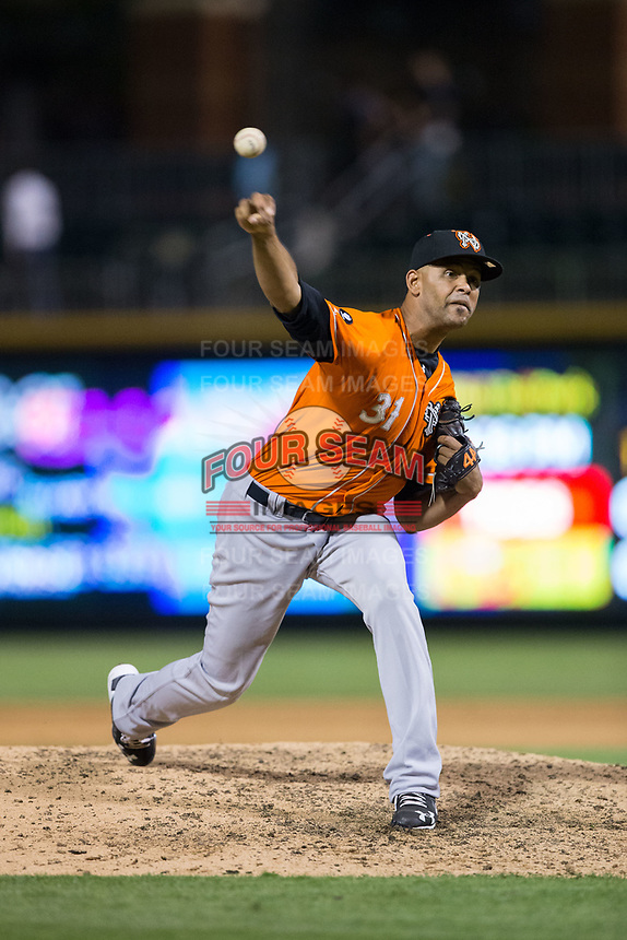 Norfolk Tides relief pitcher Richard Rodriguez (31) delivers a pitch to the plate against the Charlotte Knights at BB&T BallPark on May 2, 2017 in Charlotte, North Carolina.  The Knights defeated the Tides 8-3.  (Brian Westerholt/Four Seam Images)