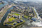 Nederland, Noord-Holland, Amsterdam, 09-04-2014;<br /> Overzicht Marineterrein (midden) en omgeving, onderin Dijksgracht, Scheepvaartmuseum,  links spoorbaan en parkeerterrein Fyra, Piet Heinkade.<br /> View Navy area and the National Maritime Museum (white building), and the eastern part of the city. Right the railroad and the international Fyra trains, waiting. <br /> luchtfoto (toeslag op standard tarieven);<br /> aerial photo (additional fee required);<br /> copyright foto/photo Siebe Swart