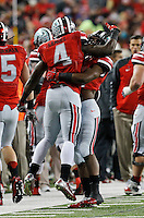 Ohio State Buckeyes running back Ezekiel Elliott (15) lifts running back Curtis Samuel (4) after Samuel scored his second touchdown of the game during the second quarter of the NCAA football game against the Illinois Fighting Illini at Ohio Stadium on Nov. 1, 2014. (Adam Cairns / The Columbus Dispatch)