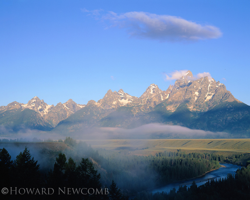 Sunrise in Grand Teton National Park, Snake River winds below.