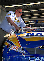 Feb 14, 2007; Daytona, FL, USA; A Nascar official measures the hood of the car of Nascar Nextel Cup driver Michael Waltrip (55) during a tech inspection during practice for the Daytona 500 at Daytona International Speedway. Mandatory Credit: Mark J. Rebilas