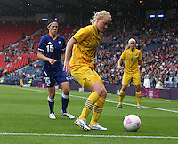 Women's Olympic Football match France v Sweden on 3.8.12...Marie Hammarstrom of Sweden and Elise Bussaglia of France, during the Women's Olympic Football match between France v Sweden at Hampden Park, Glasgow...............