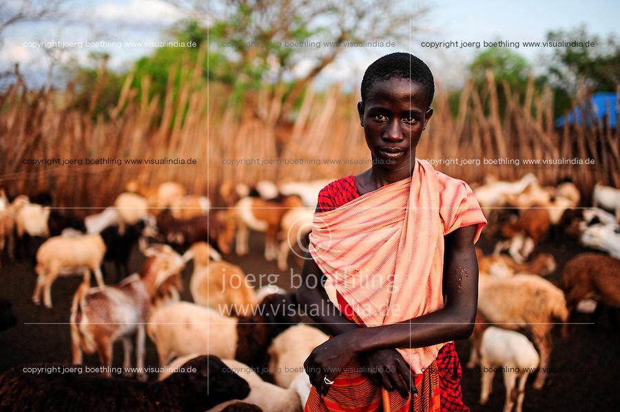 TANZANIA, Korogwe, Massai in Kwalukonge village / TANSANIA, Korogwe, Massai im Dorf Kwalukonge, JOSEPH SOGOLO mit Ziegenherde