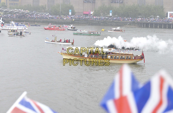 some of the boats.sailing as part of the Diamond Jubilee River Pageant, River Thames, London, England..June 3rd, 2012.gv general view water river smoke steam   .CAP/CAN.©Can Nguyen/Capital Pictures.