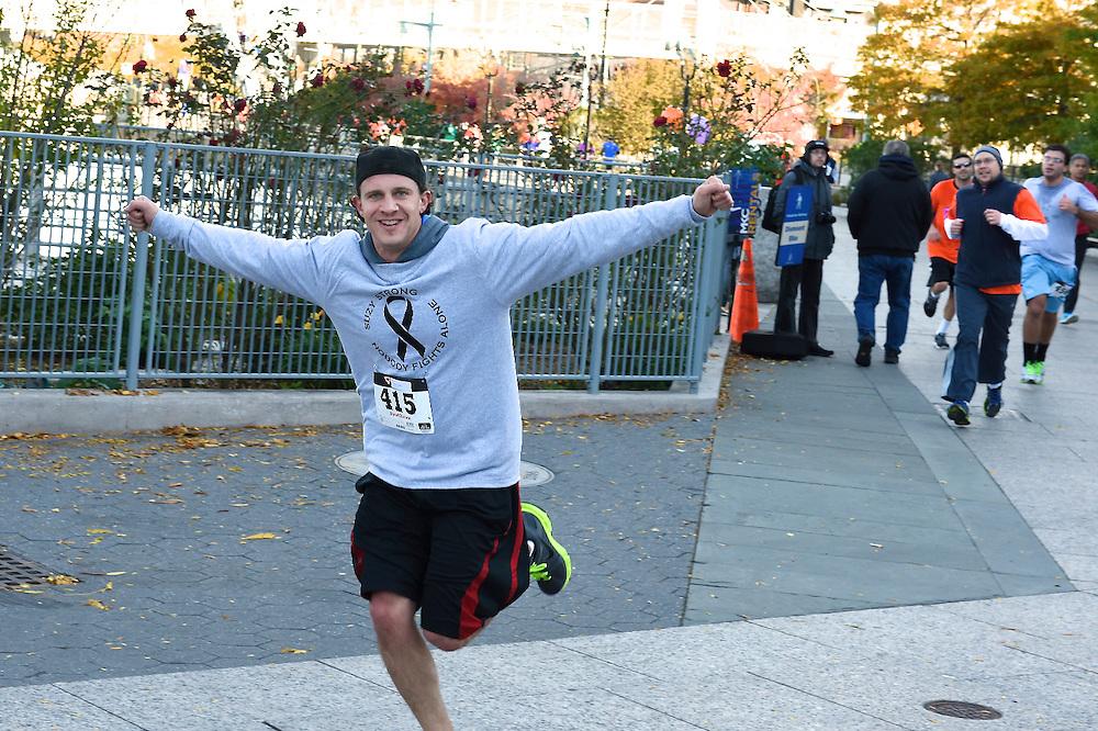 An exuberant racer near the finish line.