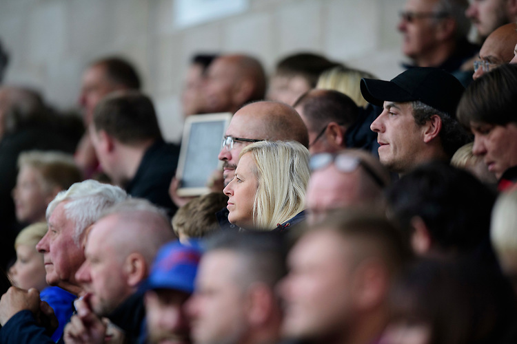 Lincoln City fans watch their team in action<br /> <br /> Photographer Chris Vaughan/CameraSport<br /> <br /> The EFL Sky Bet League One - Lincoln City v Sunderland - Saturday 5th October 2019 - Sincil Bank - Lincoln<br /> <br /> World Copyright © 2019 CameraSport. All rights reserved. 43 Linden Ave. Countesthorpe. Leicester. England. LE8 5PG - Tel: +44 (0) 116 277 4147 - admin@camerasport.com - www.camerasport.com