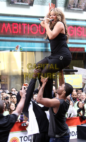 "MARIAH CAREY .performs live on NBC's ""TODAY Show"", New York, NY, USA, .2nd October 2009..concert music gig on stage performing full length  black dress dancers lifted carrying lifting up coat tights singing microphone singing .CAP/ADM/PZ.©Paul Zimmerman/Admedia/Capital Pictures"