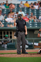 Umpire Pete Talkington calls a strike during a Midwest League game between the Clinton LumberKings and Great Lakes Loons on July 19, 2019 at Dow Diamond in Midland, Michigan.  Clinton defeated Great Lakes 3-2.  (Mike Janes/Four Seam Images)