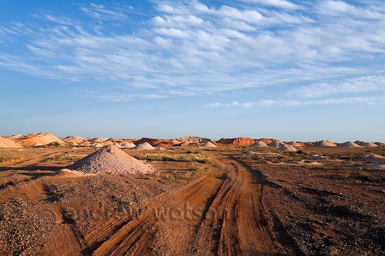 A track winds through the Coober Pedy opal fields.  Coober Pedy, South Australia, AUSTRALIA.