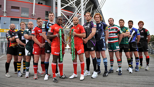 27.09.2010. Heineken Cup UK Launch at  Millennium Stadium, Cardiff, Wales. Players representing competing teams pose for a group photo infront of the Millennium Stadium, Cardiff..(Rear L-R) Tom Willis of Newport Gwent Dragons, Clarke Dermody of London Irish, Matthew Rees of Scarlets, Al Kellock of Glasgow Warriors, Paul Tito of Cardiff Blues, Alun Wyn Jones of Ospreys, Dylan Hartley of Northampton Saints, Luke Watson of Bath Rugby and Roddy Grant of Edinburgh..(Front L-R) Tom Rees of London Wasps, Yves Donguy and Fredric