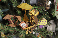 OrigamiUSA holiday tree at the American Museum of Natural History 2014. Detail of models: Chimpanzee designed by Tanaka Masashi folded by Rosalind Joyce.  Book folded by Delrosa Marshall. Mushrooms designed by Vincent Floderer, folded by Rosalind Joyce.