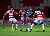 Lincoln City's John Akinde gets between Doncaster Rovers' Reece James, left, and Cameron John<br /> <br /> Photographer Andrew Vaughan/CameraSport<br /> <br /> EFL Leasing.com Trophy - Northern Section - Group H - Doncaster Rovers v Lincoln City - Tuesday 3rd September 2019 - Keepmoat Stadium - Doncaster<br />  <br /> World Copyright © 2018 CameraSport. All rights reserved. 43 Linden Ave. Countesthorpe. Leicester. England. LE8 5PG - Tel: +44 (0) 116 277 4147 - admin@camerasport.com - www.camerasport.com