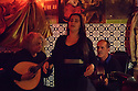 Lisbon, Portugal. 05.05.2015. Ana Catarina Grilo, Fadista, sings in restaurant Coracao de Alfama, where she is a resident performer. Accompanying her are Mucio Sa, on Portuguese Guitar, and Paulo Santos, on Classical Guitar. Photograph © Jane Hobson.