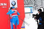 HOLMENKOLLEN, OSLO, NORWAY - March 16: Winner Alexander Legkov of Russia (RUS) ?ugs 3rd place Ilia Chernousov of Russia (RUS) during the prize giving ceremony of the Men 50 km mass start, free technique, at the FIS Cross Country World Cup on March 16, 2013 in Oslo, Norway. (Photo by Dirk Markgraf)