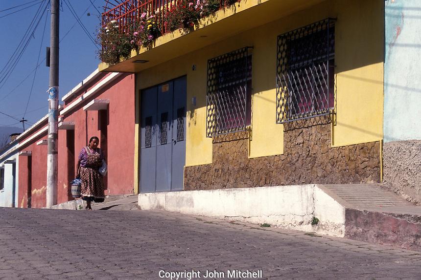 Woman walking down a street  in the city of Quetzaltenango, Guatemala