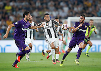 Calcio, Serie A: Juventus vs Fiorentina. Torino, Juventus Stadium, 20 agosto 2016.<br /> Juventus&rsquo; Dani Alves, center, is challenged by Fiorentina&rsquo;s Davide Astori, left, and Gonzalo Rodriguez, during the Italian Serie A football match between Juventus and Fiorentina at Turin's Juventus Stadium, 20 August 2016. Juventus won 2-1.<br /> UPDATE IMAGES PRESS/Isabella Bonotto