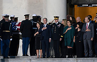 Members of the Bush family including former First Lady Laura Bush and President George W. Bush watch as a military casket team carries casket of former President George. H. W. Bush to the Capitol Rotunda in Washington, DC where he will lie state, December 3, 2018. <br /> CAP/MPI/RS<br /> &copy;RS/MPI/Capital Pictures