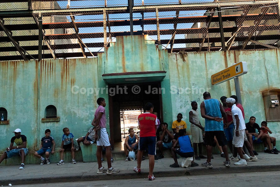 Young Cuban boxers wait before a training session in front of Rafael Trejo boxing gym in Havana, Cuba, 13 February 2010. During the last 30 years Cuba has produced more World Champions and Olympic gold medallists in amateur boxing than any other country. Many famous fighters, who came out of Cuba, were training at Rafael Trejo boxing gym in their youth. This run down open air facility in the Old Havana is a place of learning and mastering the art of boxing by the old school style. Boys begin their training very young. As sports are given a high political priority in Cuba, all children are systematically encouraged to develop their skills. Those who succeed will become heroes of Cuban society.