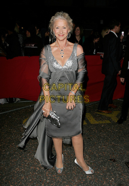 Dame HELEN MIRREN.Arrivals - Greatest Britons 2007 Awards Show, .The London Studios, London, Engand, May 21st 2007..full length grey silver sequined low cut dress floaty clutch bag purse peep-toe shoes diamond necklace.CAP/AH.©Adam Houghton/Capital Pictures.