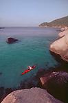 Thailand, Woman sea kayaking, Ko Nang Yuan, Nang Yuan resort, Ko Tao, Islands in the Gulf of Thailand,