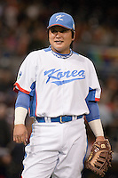 17 March 2009: #52 Tae Kyun Kim of Korea warms up prior to the 2009 World Baseball Classic Pool 1 game 4 at Petco Park in San Diego, California, USA. Korea wins 4-1 over Japan.