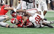 January 8th 2018, Atlanta, GA, USA;  The Crimson Tide defense wrap up Georgia Bulldogs running back Nick Chubb (27) during the College Football Playoff National Championship Game between the Alabama Crimson Tide and the Georgia Bulldogs on January 8, 2018 at Mercedes-Benz Stadium in Atlanta, GA.