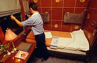 Steward preparing bed in a suite of Al Andalus Expreso.