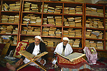 epa03771211 Elderly Yemeni men read the Islam's Koran book at a mosque a week before Ramadan begins, in the Old City of Sana'a, Yemen, 02 July 2013.  Muslims throughout the world consider Ramadan, the ninth month of the Islamic calendar, as a special and holy month for making more charity and more reading of the Koran.  EPA/YAHYA ARHAB