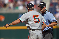 Oregon State head coach Pat Casey (5) argues with first base umpire Chris Coskey during Game 11 of the 2013 Men's College World Series against the Mississippi State Bulldogs on June 21, 2013 at TD Ameritrade Park in Omaha, Nebraska. The Bulldogs defeated the Beavers 4-1, to reach the CWS Final and eliminating Oregon State from the tournament. (Andrew Woolley/Four Seam Images)