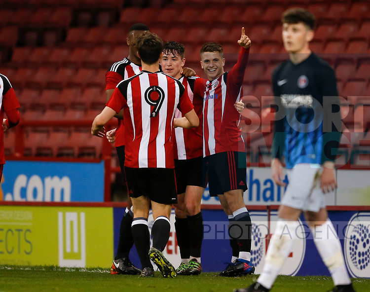 George Cantrill of Sheffield Utd is mobbed after scoring the second goal during the U18 Professional Development League 2 play off semi final match at  Bramall Lane, Sheffield. Picture date: April 21st 2017. Pic credit should read: Simon Bellis/Sportimage