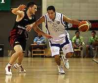 Saints guard Troy McLean tries to get past Cougars guard Gerard Bowden during the NBL match between the Wellington Saints and Christchurch Cougars at Te Rauparaha Stadium, Porirua, Wellington, New Zealand on Saturday 4 April 2009. Photo: Dave Lintott / lintottphoto.co.nz