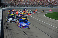 Greg Biffle (#16) leads the field on the first lap.