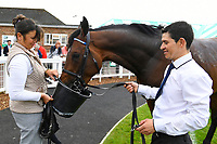 Winner of The Penang Turf Club Malaysia Novice Stakes  Humanitarian ridden by Robert Havlin and trained by John Gosden takes a drink in the Winners eclosure during Afternoon Racing at Salisbury Racecourse on 16th May 2019