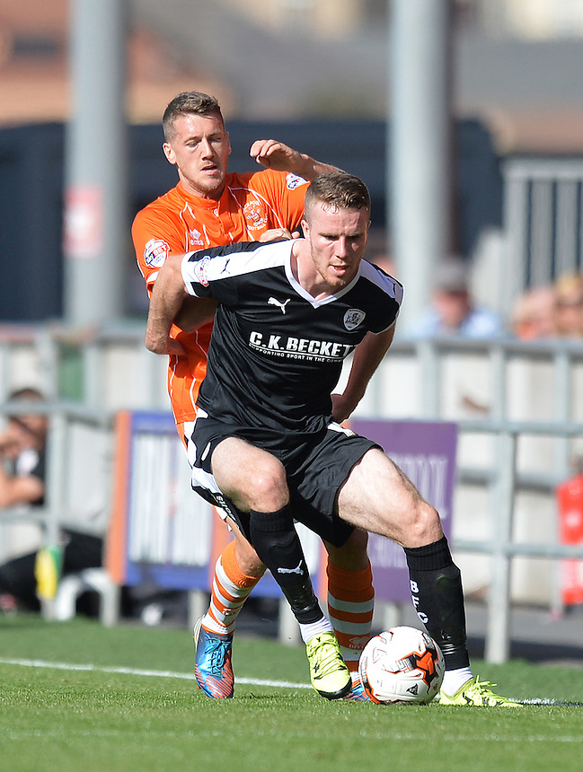 Blackpool's Jim McAlister battles with Barnsley's Marley Watkins<br /> <br /> Photographer Dave Howarth/CameraSport<br /> <br /> Football - The Football League Sky Bet League One - Blackpool v Barnsley - Saturday 19th September 2015 - Bloomfield Road - Blackpool<br /> <br /> &copy; CameraSport - 43 Linden Ave. Countesthorpe. Leicester. England. LE8 5PG - Tel: +44 (0) 116 277 4147 - admin@camerasport.com - www.camerasport.com
