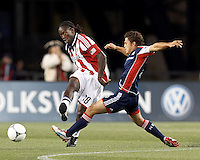 Chivas USA midfielder Shalrie Joseph (18) passes the ball. In a Major League Soccer (MLS) match, the New England Revolution tied Chivas USA, 3-3, at Gillette Stadium on August 29, 2012.
