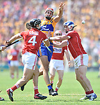 Peter Duggan of Clare in action against Colm Spillane and Sean O Donoghue of Cork during their Munster senior hurling final at Thurles. Photograph by John Kelly.