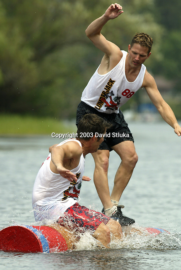 7/25/03 -Hayward, Wisconsin. Log rolling competition at the Lumberjack World Championships. Sean Duffy (77) and Brian Duffy (88). (Photo by David Stluka)