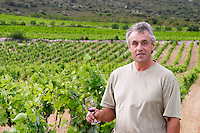 Alain Caujolle-Gazet Domaine des Grecaux in St Jean de Fos. Montpeyroux. Languedoc. Owner winemaker. France. Europe. Wine glass. Vineyard.