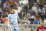 09 June 2011: Kansas City's Luke Sassano (left) heads the ball over Chicago's Logan Pause (right). Sporting Kansas City played the Chicago Fire to a 0-0 tie in the inaugural game at LIVESTRONG Sporting Park in Kansas City, Kansas in a 2011 regular season Major League Soccer game.