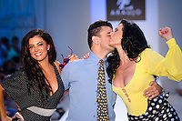 Real Housewives of Miami, Adriana De Moura, Designer A.Z. Araujo, and Cozete Gomes walk runway at A.Z Araujo Swimwear Show during Mercedes Benz IMG Fashion Swim Week 2014 at The Raleigh Hotel, Miami Beach, FL on July 21, 2013