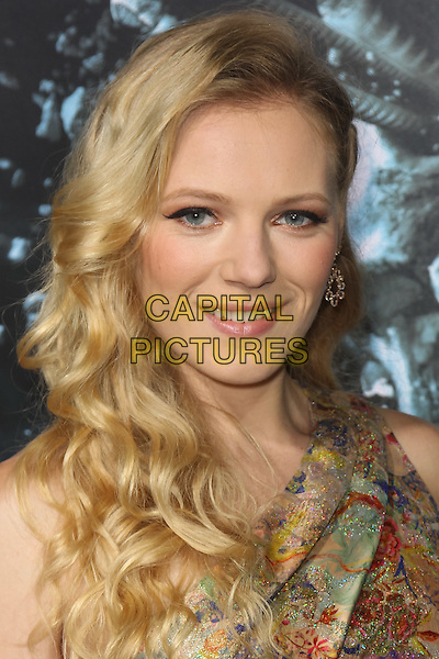 "EMMA BELL.Los Angeles special screening of New Line Cinema's ""Final Destination 5"" at Grauman's Chinese Theatre. Hollywood, CA USA. .August 10th, 2011.headshot portrait gold beige print green red wavy hair .CAP/CEL.©CelPh/Capital Pictures."