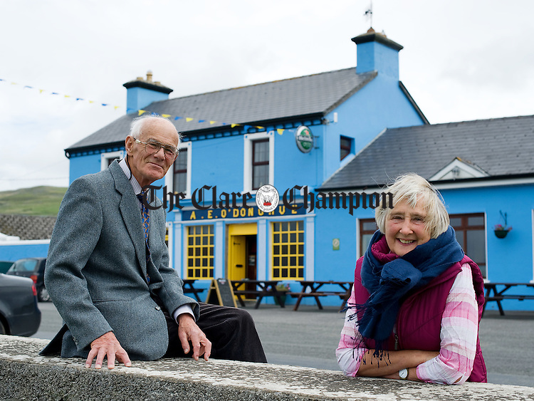 Brendan and Catherine O Donoghue outside the family pub O Donoghue's of Fanore which is celebrating 100 years this year. Photograph by John Kelly.