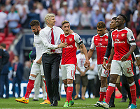 Arsenal Manager Arsene Wenger with Mesut Ozil of Arsenal on the final whistle during the FA Cup FINAL match between Chelsea and Arsenal at Wembley Stadium, London, England on 27 May 2017. Photo by Andy Rowland.
